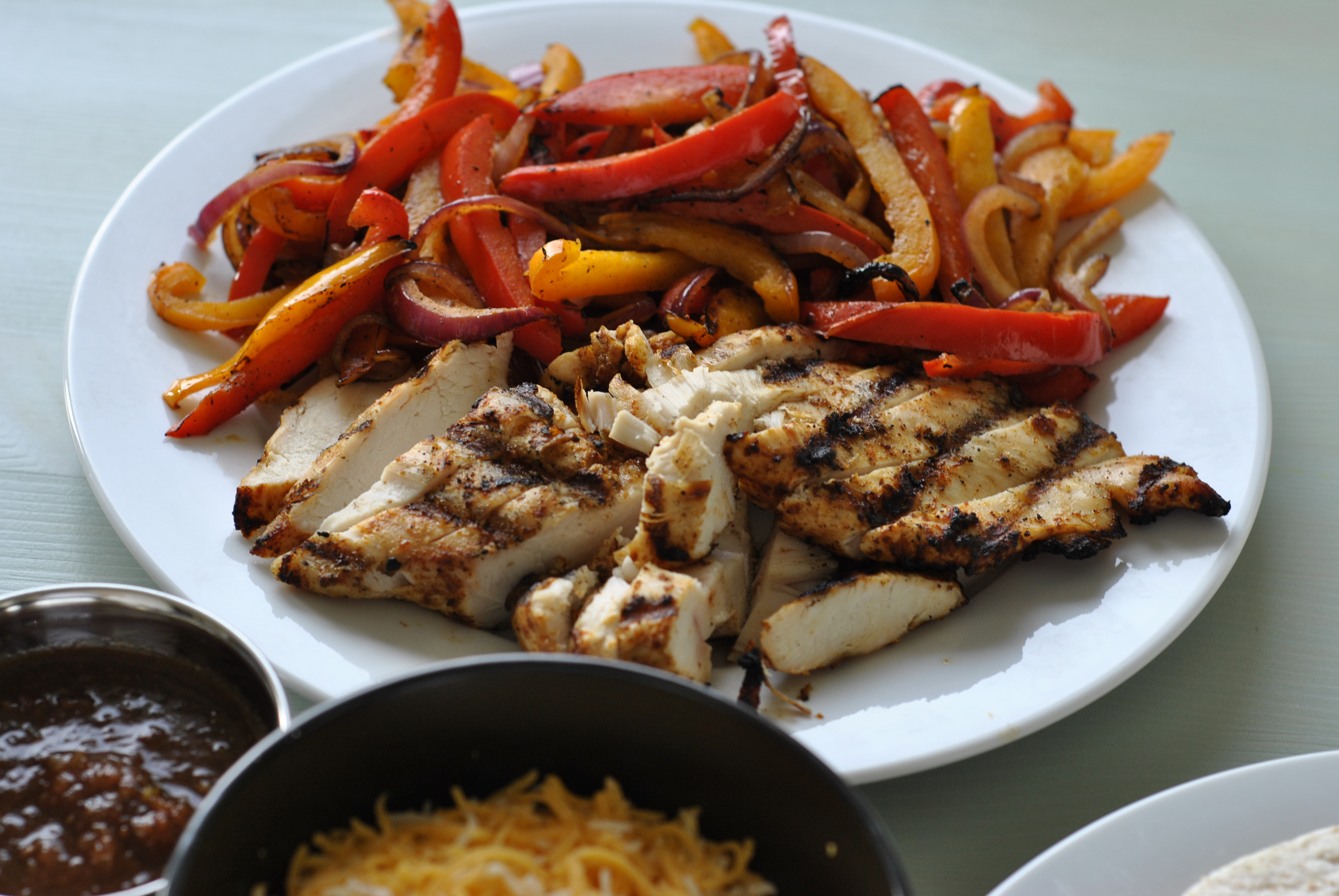 Chicken, grilled peppers and onions ready to be loaded onto the tortillas