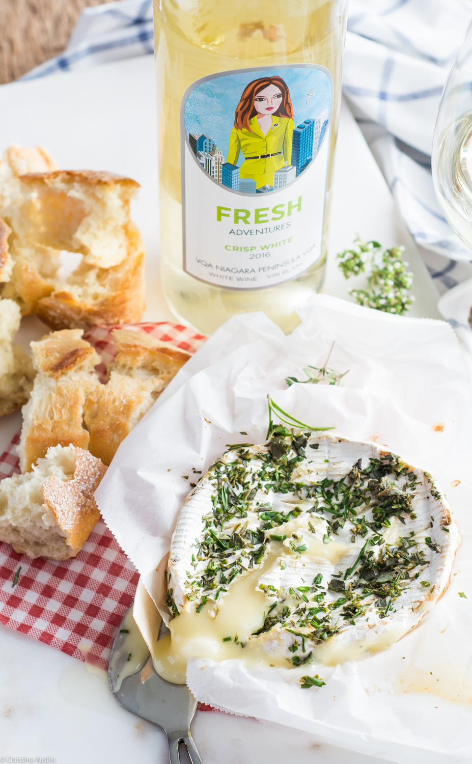 Baked Camembert with herbs and wine